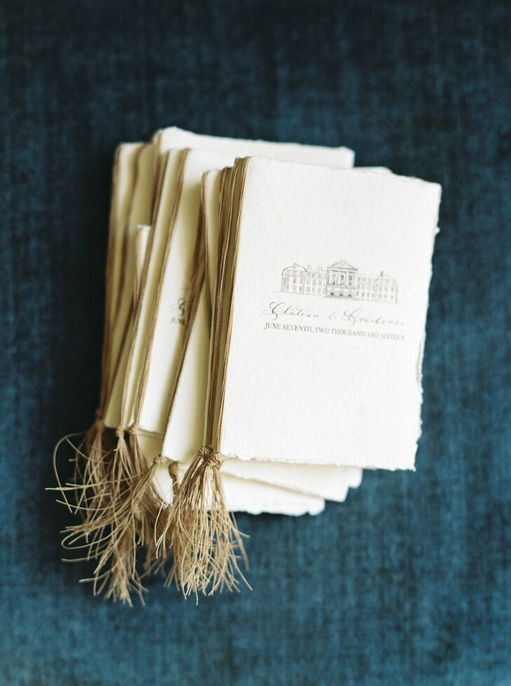 In addition to the invitations, Lindsay of House of Hanna designed the programs for the ceremony. Raffia binding and torn-edge ivory paper gave the programs a rustic, old world feel, while ornate script and an illustration of the Chateau channeled a refined, regal aesthetic.