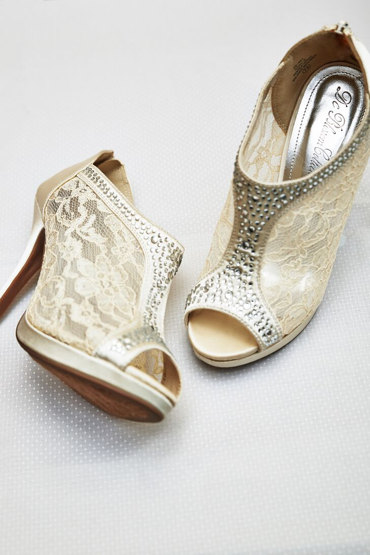 Shirley wore champagne colored shoes, covered in lace with an open toe.