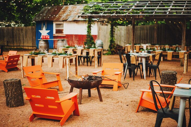 Fire Pit With Orange Lounge Chairs