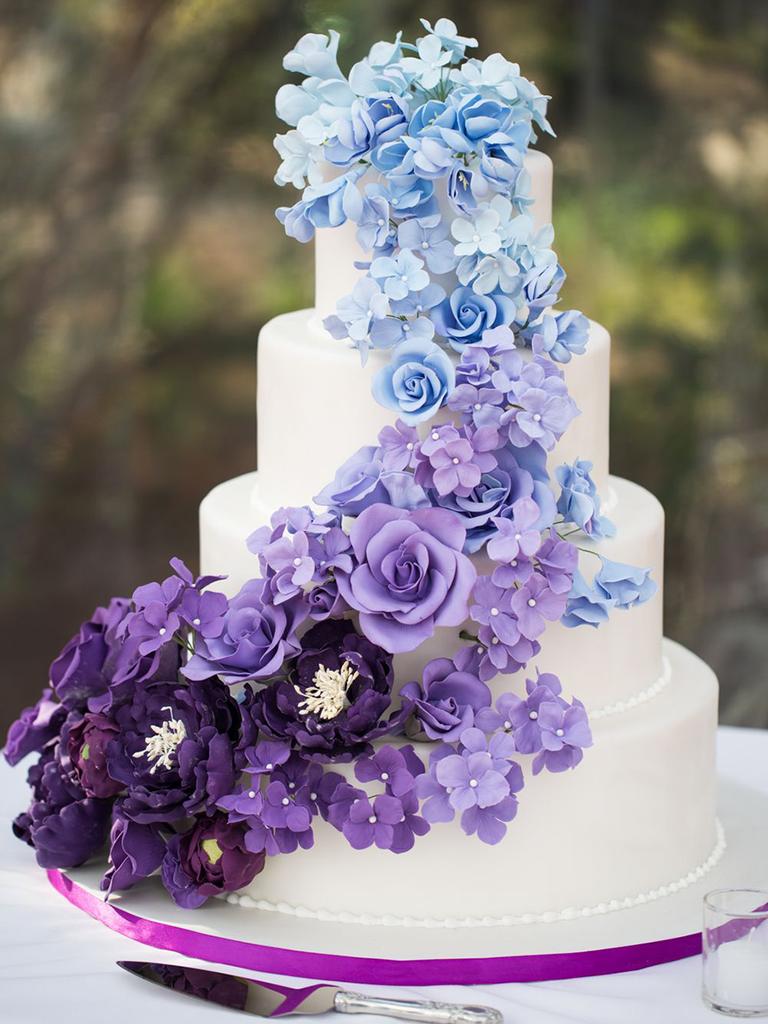 wedding cake sugar flowers in purple and blue