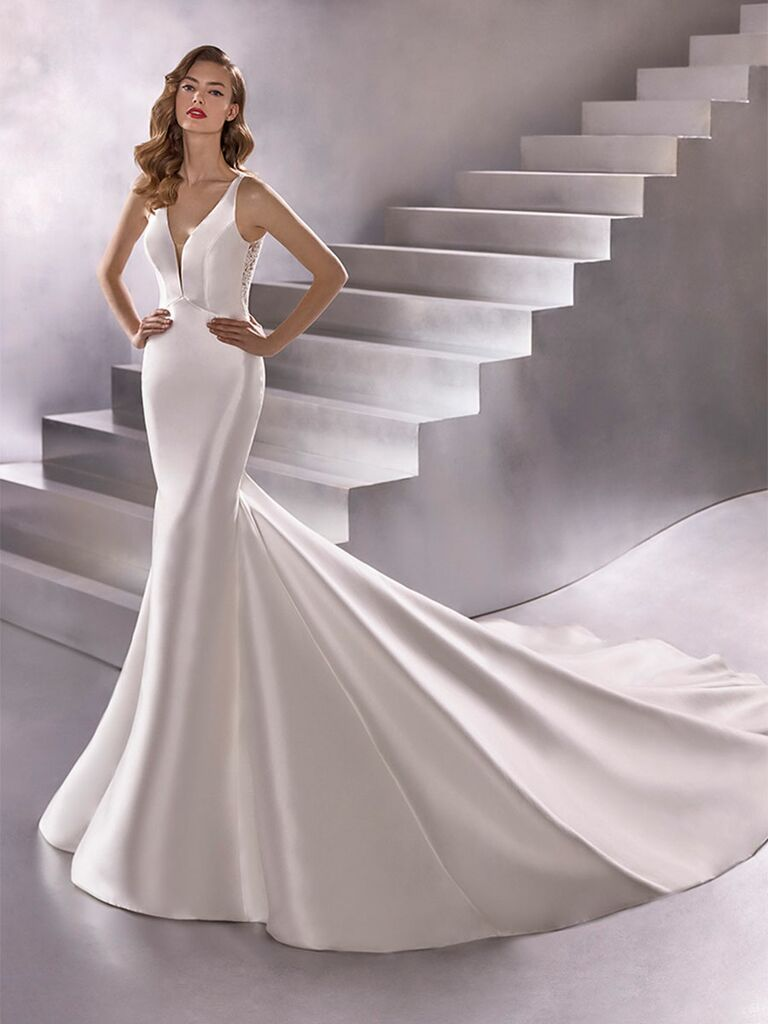 Atelier Provonias wedding dress mermaid gown with plunge neckline and lace back
