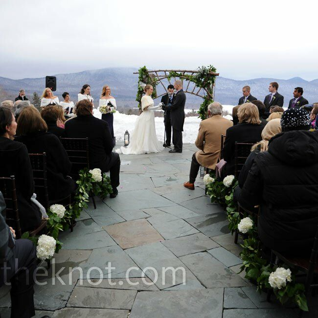 Despite the cold, the ceremony took place outside overlooking the Green Mountains and Chittenden Reservoir. An arbor of garland-covered branches set a rustic tone.