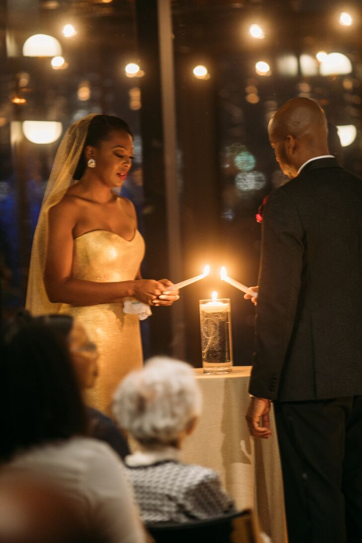 Romantic Couple Lighting Candle During Unity Ceremony
