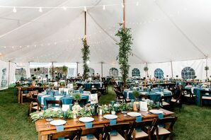 Tented Reception with Greenery, Blue Linens, Wood Tables and String Lights