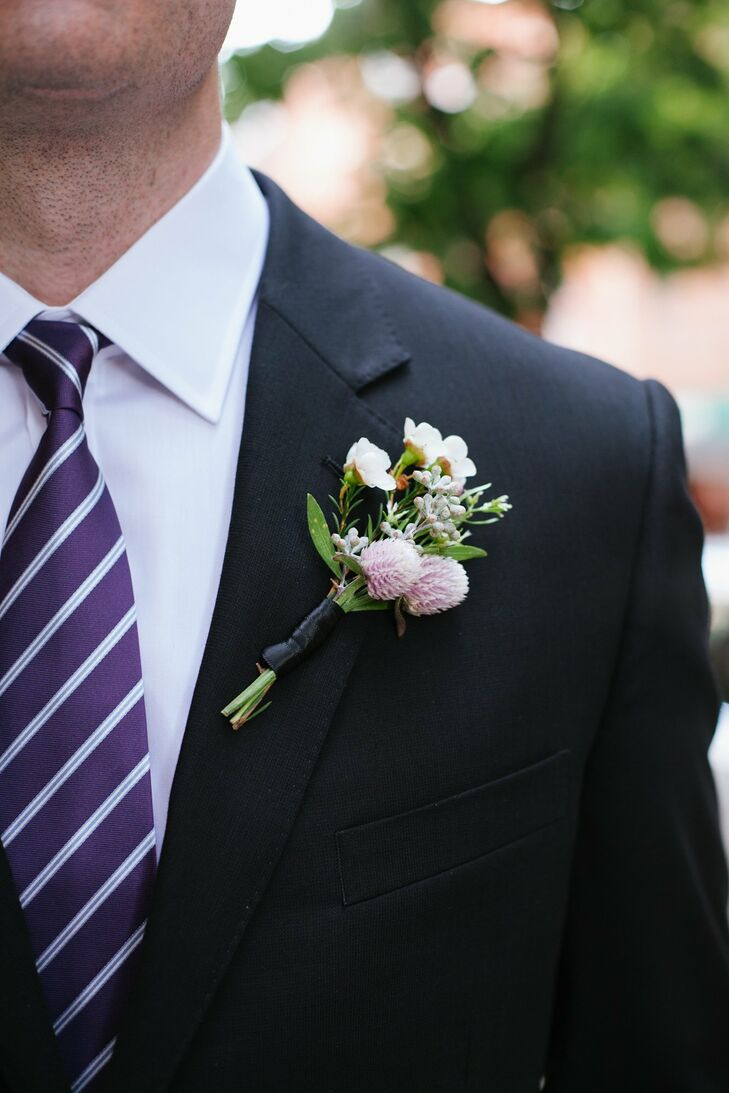Tiny waxflowers, seeded eucalyptus and thistles were a masculine combination on the men's lapels.