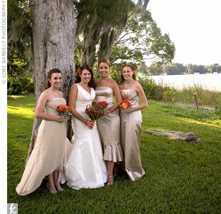 The neutral champagne color of the bridesmaid dresses was chosen to make the orange bouquets stand out. Each maid was decked out in a unique dress, featuring varying lengths and design elements, while the guys' looks were consistent.