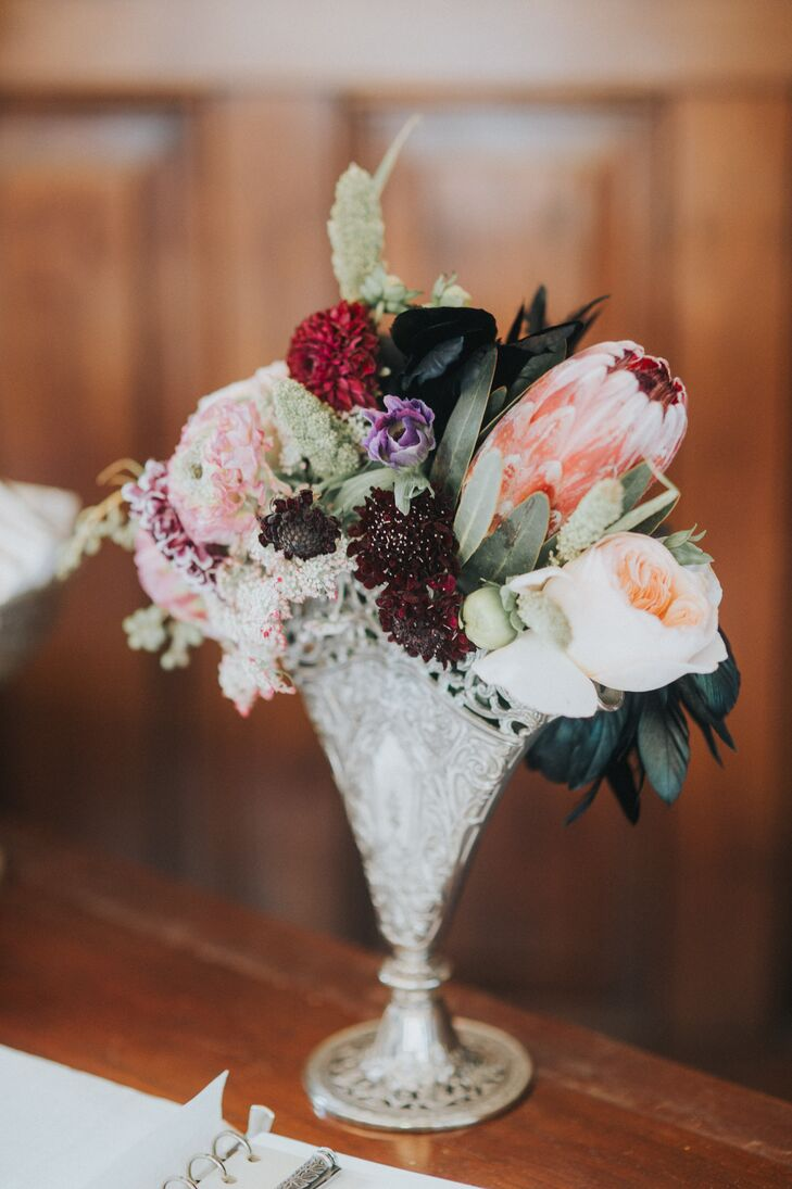 Vintage vases filled with fall blooms added a vintage look to Victoria and Johnny's reception space at the Southern Railway Station in Knoxville, Tennessee.