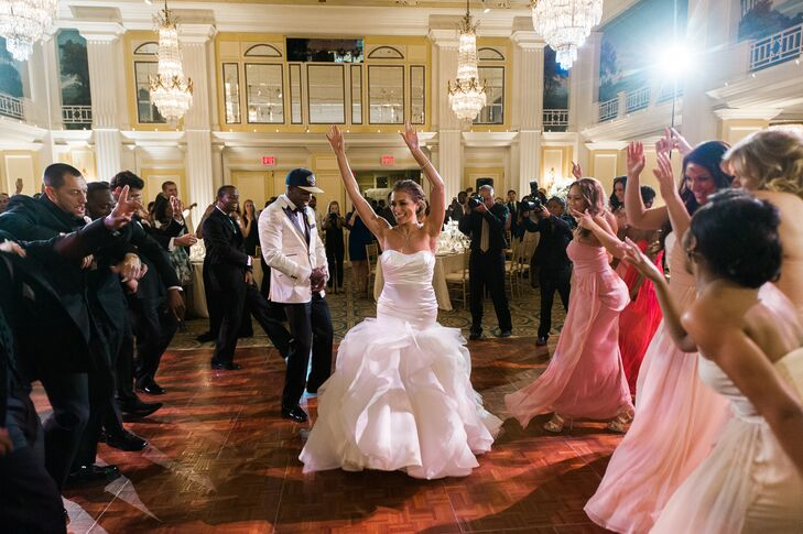 """Jackie and Donovan entered the reception with their wedding party to the tune of """"Yeah 3x"""" and """"Look at Me Now"""" by Chris Brown."""