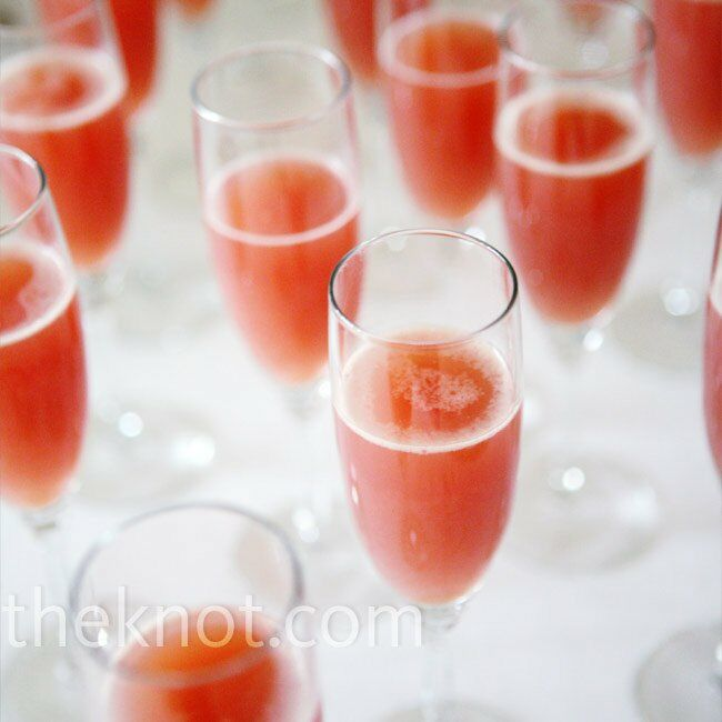 Guests sipped a signature cocktail of champagne and juice while music played in the background.