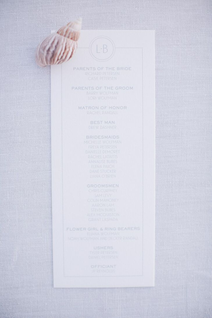 Leah and Brian had Sugar Paper create simple and contemporary wedding programs with clean fonts in pale blue on crisp white stationary topped with a custom monogram.