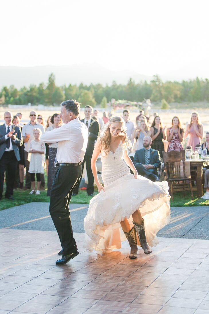 """Abigail wore a beloved pair of cowboy boots with her gown, allowing for lively dancing. """"I wore my dressiest pair of cowgirl boots. They had a white embroidered design, which paired well with the lace on my gown."""""""