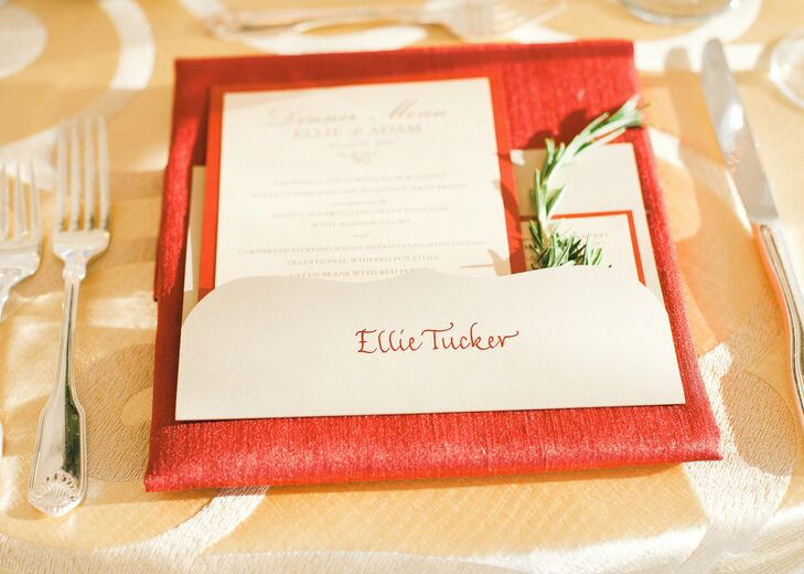 The names of each guest were hand-calligraphed in red ink on simple ivory cards, complementing the linens and menu cards on which they were laid.