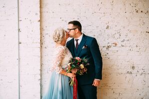 Groom in Classic Blue Suit and Bride Wearing Elegant Dress with Blue Skirt