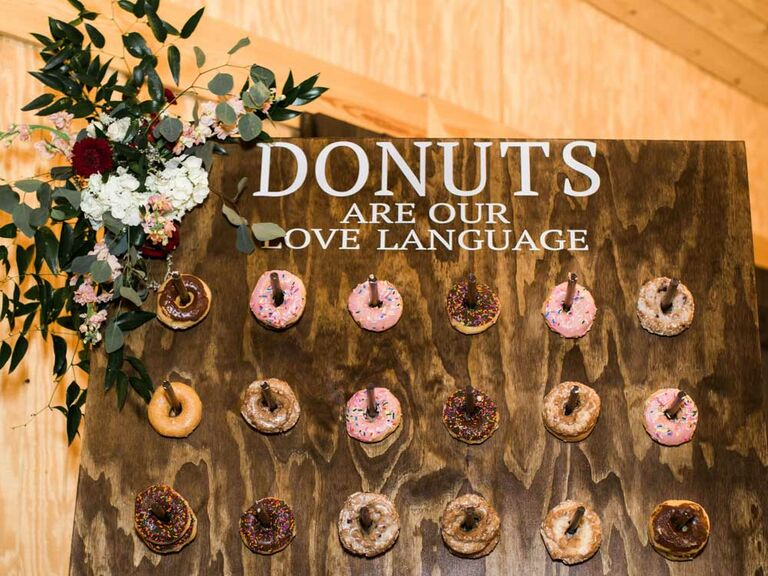 Dark wood stain donut wall with floral arrangement