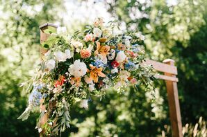 Wood Wedding Arch with Whimsical Flower Arrangement