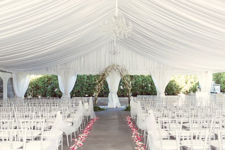 White Tented Ceremony with Chandelier and Branch Arch