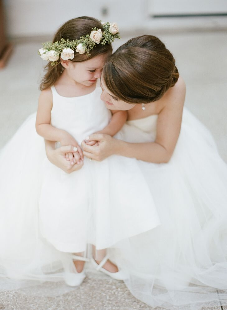 The flower girl wore a white dress with a seeded eucalyptus and rose flower crown.