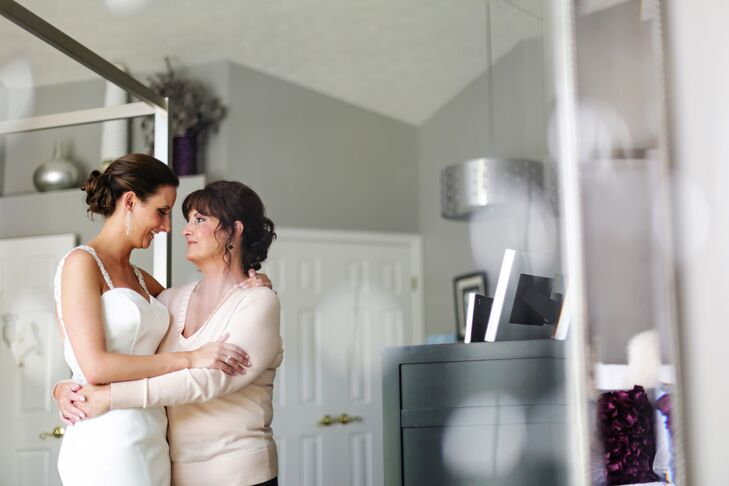 The mother-of-the-bride and her daughter share a sentimental moment before the ceremony.