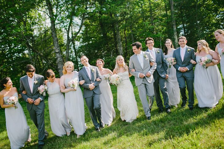 The bridesmaids wore floor-length, dove gray chiffon gowns. The groomsmen wore gray suits with pink ties.