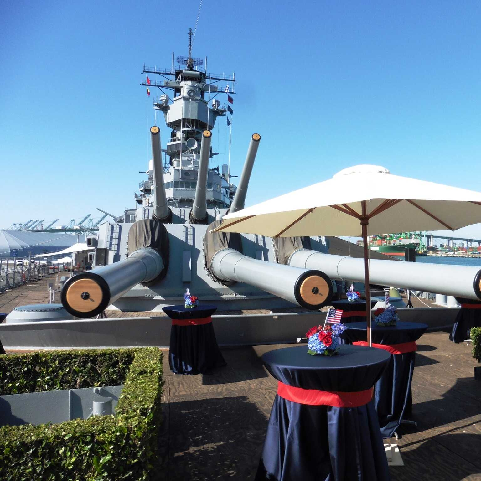 The Foc'sle event space is located onboard the Battleship IOWA Museum in San Pedro, CA. Here, event attendees can inhabit the same space as three former US presidents. This venue is operated by the Pacific Battleship Center, with proceeds from events held here going towards the preservation and restoration of this storied vessel.  The Space During the ship's 50 years of service, the Foc'sle served as the sleeping area for the crew when at sea. Now, it provides a scenic location for open-air...