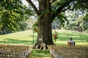 Ceremony Site with Wedding Arch and Chiavari Chairs at Schiller Park in Columbus, Ohio