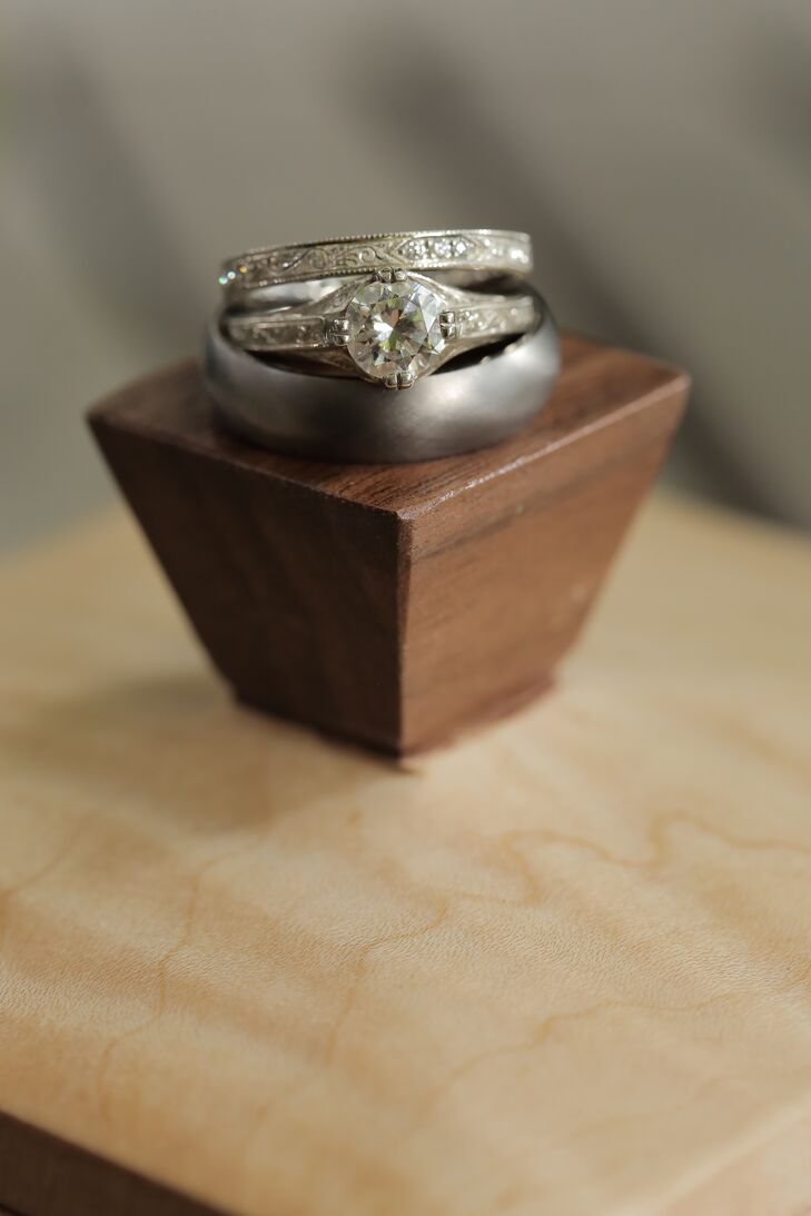 """The couple designed the bride's ring together with a local jewelry designer. """"The diamond was my grandmother's, and so we created a vintage-inspired setting with engraving on the band to give it a unique touch,"""" Holly says."""