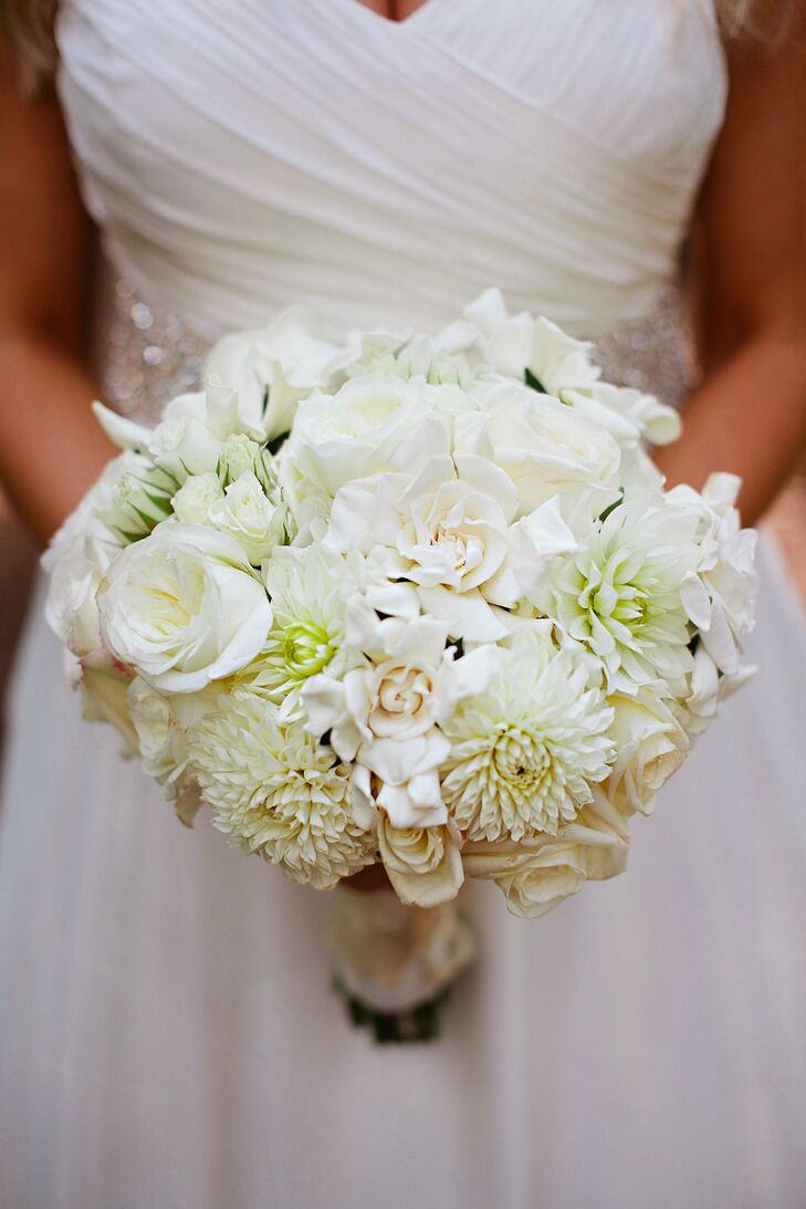 I knew from the beginning I wanted all of the flowers to be white. I have always loved an all-white bouquet, says Sarah of her cabbage rose, spray rose, hydrangea and gardenia filled bouquet.