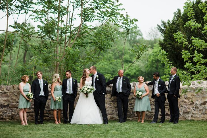 Caitlin and Hugh's wedding party consisted of four bridesmaids and five groomsmen. The pair opted for simple and elegant when it came to their wedding party's attire, choosing silk chiffon dresses by J.Crew in a soft shade of dusty shale for the bridesmaids and dark charcoal gray suits by Indochino for the groomsmen.