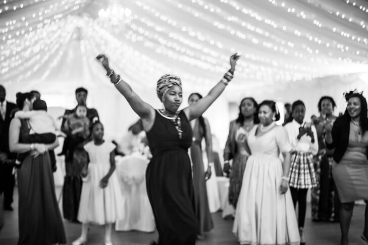 Dancing took place in the tented pavilion at Parklands, Quendon Hall. The venue was decorated with beautiful string lights that twinkled above guests as they danced.