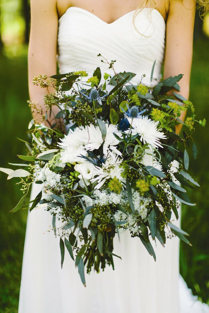 Marisa's oversize bouquet was a mix of eucalyptus, airplants, thistle, mums, Queen Anne's lace and freesia. I wanted it to look big and wild, as if I had just picked it myself that morning, Marisa says.