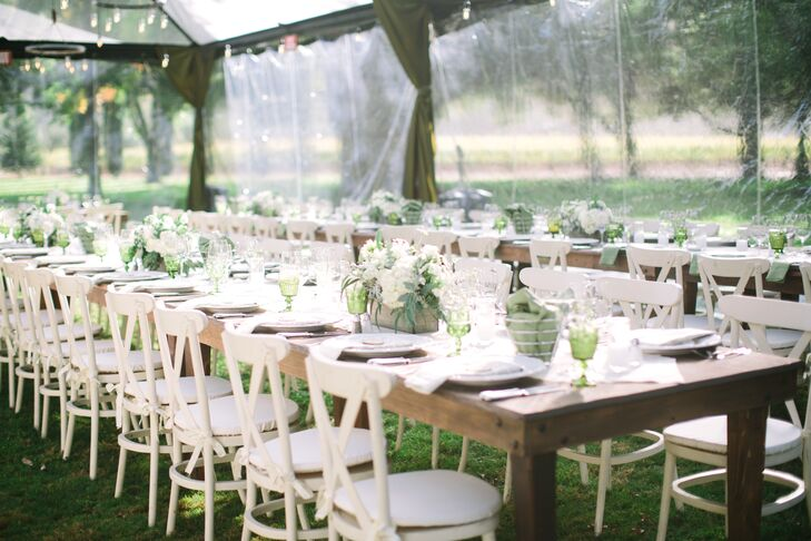 """""""I wanted the tables to look like someone (with impeccable taste) had pulled out their old dining room tables to the lawn and set up the most wonderful dinner for all of their closest friends,"""" says Sloane. """"For that reason, we had long farmhouse tables and only a runner down the middle. Each table each had one large box of flowers with hydrangeas, olive leaves, ivy, white daisies, roses and ferns as a centerpiece."""""""