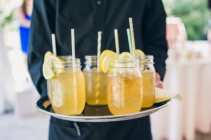 """""""We wanted our guests to experience Southern cooking at it's best,"""" Heather says. """"We served a specialty cocktail drink before the ceremony to help to lighten the mood. Naturally, it had to be sweet tea vodka and iced tea to reflect the South."""" The delicious cocktails were served in mason jars with patterned paper straws."""