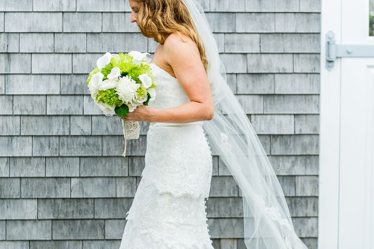 The bride wanted a simple lace dress, and fell in love with this strapless tiered lace gown from J.Crew with a sweetheart neckline. She paired it with a long veil and nude strappy heels.