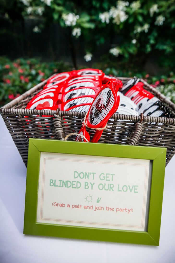"""Each guest was given custom red sunglasses with """"I hear E& J"""" printed on the lenses.rn"""