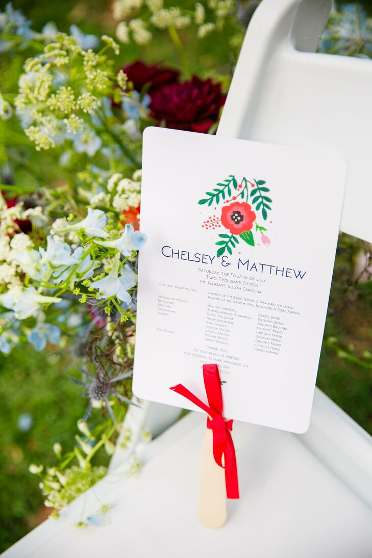 Chelsey assembled all the ceremony programs herself using the same art from the invitation suite (gorgeously done by Minted). The red bows were the perfect touch to tie it all together.
