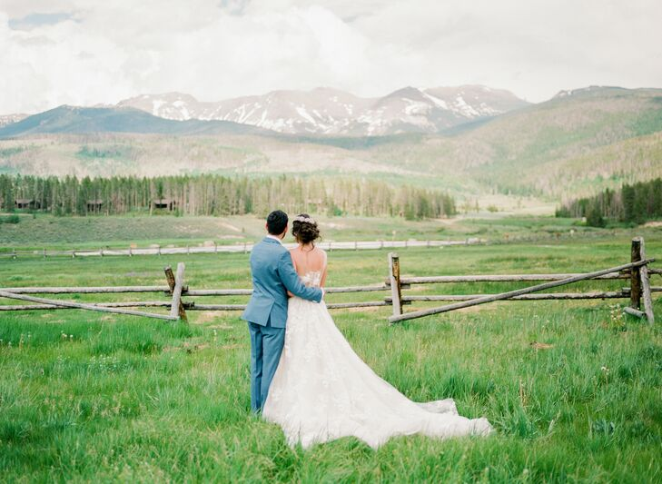 Couple Hugging and Looking at Mountains During Colorado Wedding