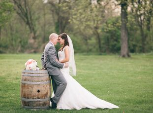 From the wine-cork-filled aisle decor to the wrapped bottle centerpieces, everything about Rebecca Miller (24 and a student) and Tyler Miller's (29 an