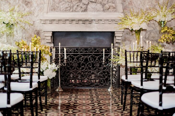 The ceremony unfolded in the Stone Room at Westwood Country Club in Austin, Texas. A stone fireplace complete with an ornate iron grate provided a refined backdrop for Ken and Pat's vows, with details such as silver candelabras and lush bouquets of white hydrangeas, stock, dendrobium orchids and phalaenopsis orchids adding to the romance of the scene.