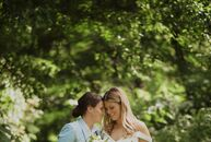 """For their romantic garden wedding in Hartford, Connecticut, Mary Kate, dressed in a custom suit from Bindle and Keep, """"was my 'something blue,'"""" Elena"""