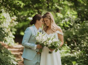 "For their romantic garden wedding in Hartford, Connecticut, Mary Kate, dressed in a custom suit from Bindle and Keep, ""was my 'something blue,'"" Elena"