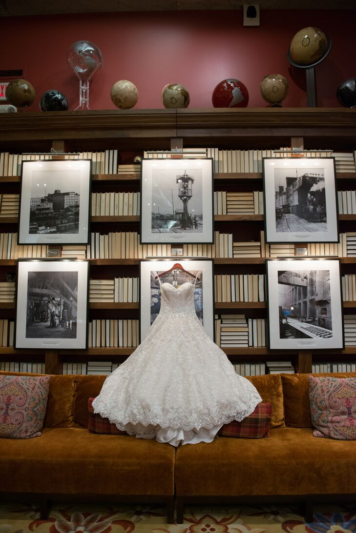 """""""My mom told me from the beginning that she knew I was going to get a ball-gown-style dress,"""" Marisa says. """"It's what I always choose for special occasions."""" She ended up falling for a strapless, lacy A-line gown with a trail of buttons down its back. Some of the lace from the bottom of her dress was stitched onto her veil."""