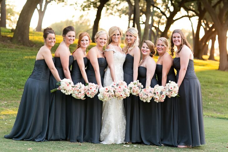 Kaitlynn's bridesmaids wore strapless slate dresses that had a fitted ruched bodice and a floor-length skirt. They each carried a bouquet of peach David Austin garden roses, silver brunia and white hydrangeas to accent the palette.