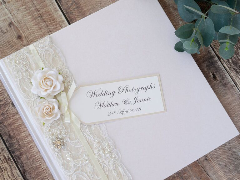 Classic white wedding album with lace