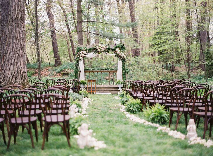 The altar was decorated in greenery and flowers; the aisle featured moss rabbits, rabbit lanterns and potted ferns. A trail of white rose petals created an outdoor aisle.