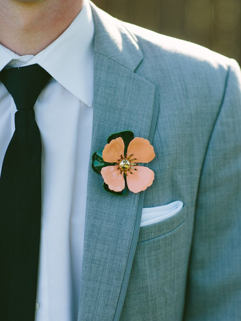 Orange flower brooch boutonniere