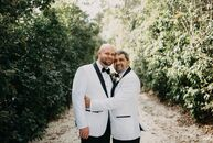 Derek and Herman Fusko put a masculine twist on their timeless garden wedding with a color palette of black, white and gold and lots of earthy, natura