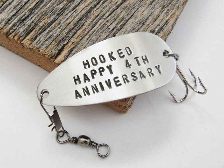 Metal fishing lure stamped with Hooked Happy 4th Anniversary