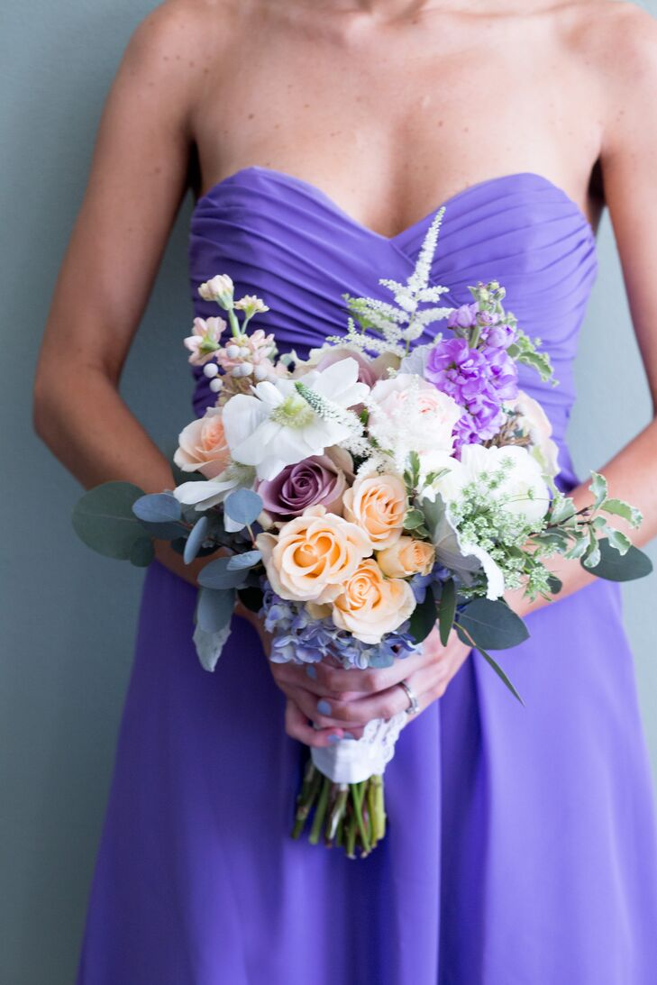 The bridesmaids carried bouquets that echoed Dana's bridal bouquet. They were made up of peach, lavender and blush roses, pink and purple stock, astilbes, purple hydrangeas, silver brunia and Queen Anne's lace.