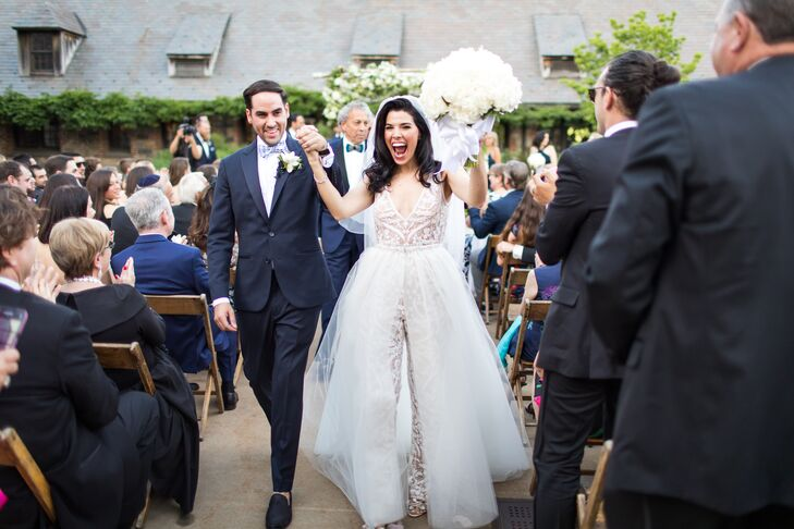 Modern Couple Recessing in Navy Tuxedo and White Jumpsuit