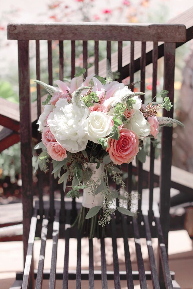 Anna's bridal bouquet consisted of lush white and blush flowers, including peonies, spray roses, lilies and veronica with touches of seeded eucalyptus around the base.